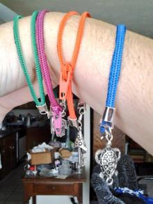 Zipper bangles with charms!  Yes, they zip and unzip. :)