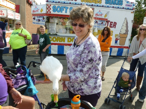 Plus, my mom and I each let a duck stand on our hand.  Here is a picture of my mom doing so.