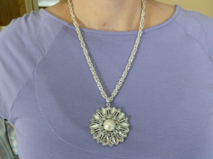 Crystallized in snow necklace.  This one is silver with little flecks of white in the chain to really accent the pendant.
