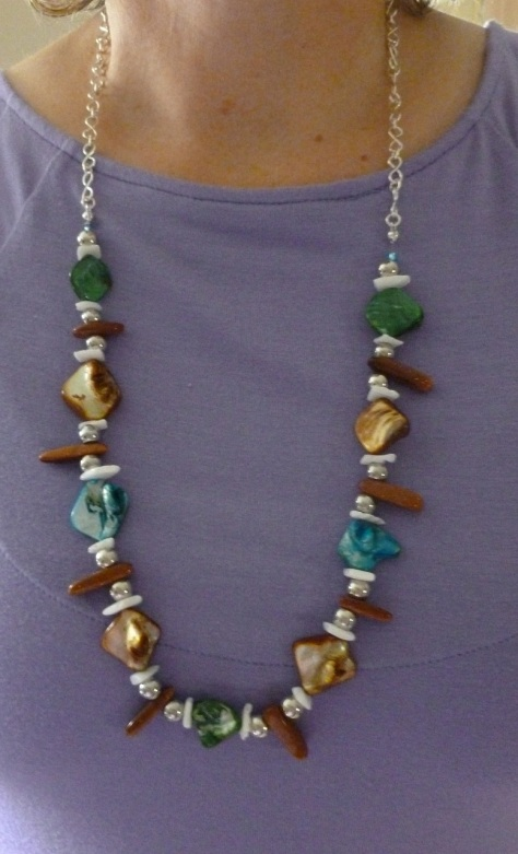 This one was a collaboration between my mom and I. She did the beads, I made the chain. :)