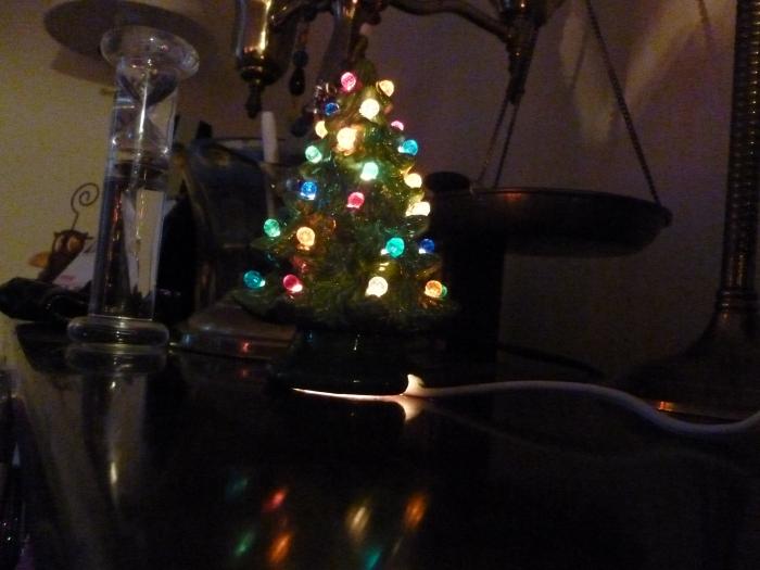I put my tiny tree I made last Christmas on my desk.