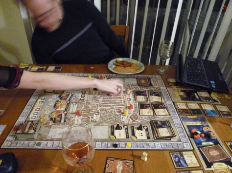 During Lord of Waterdeep, one of my friends was playing this with us, playing a game on his tablet, talking to his boyfriend on Skype while his boyfriend was playing a boardgame.  Yep, we made fun of him for this too. :p